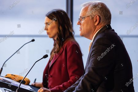 New Zealand Prime Minister Jacinda Ardern (L) and Australian Prime Minister Scott Morrison speak during a joint press conference held at The Nest in Queenstown, New Zealand, 31 May 2021. Australian Prime Minister Scott Morrison is on a two-day visit to New Zealand to attend the annual Australia-New Zealand Leaders' Meeting.