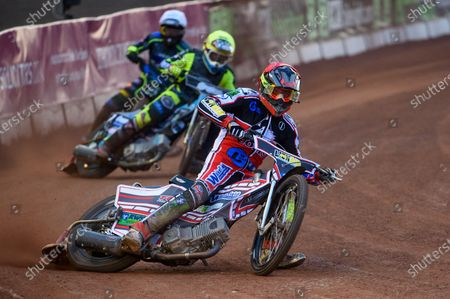 Stock Image of Jack Parkinson-Blackburn  (Red) leads Mason Watson  (Yellow) and Kyle Bickley  (White) during the SGB National Development League match between Belle Vue Colts and Berwick Bullets at the National Speedway Stadium, Manchester on Friday 28th May 2021.
