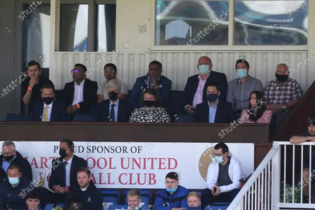 Hartlepool United's Chairman Raj Singh (back row centre) and Tees Valley Mayor Ben Houchen (next row 2nd from right) look on during the Vanarama National League match between Hartlepool United and Weymouth at Victoria Park, Hartlepool on Saturday 29th May 2021.