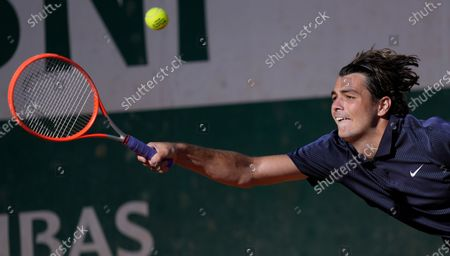 United States's Taylor Fritz plays a return to Portugal's Joao Sousa during their first round match on day two of the French Open tennis tournament at Roland Garros in Paris, France