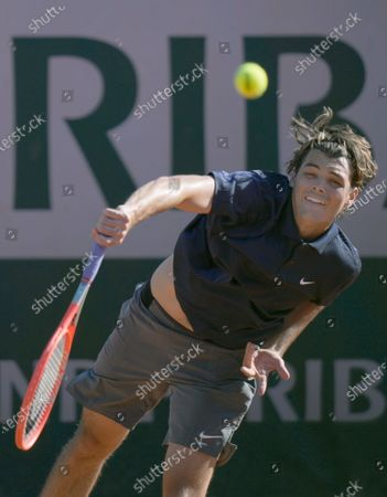 United States's Taylor Fritz serves to Portugal's Joao Sousa during their first round match on day two of the French Open tennis tournament at Roland Garros in Paris, France