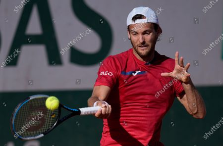 Portugal's Joao Sousa plays a return tp United States's Taylor Fritz during their first round match on day two of the French Open tennis tournament at Roland Garros in Paris, France