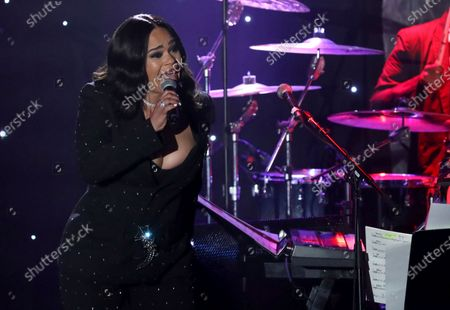 Faith Evans performs on stage at the Pre-Grammy Gala And Salute To Industry Icons, in Beverly Hills, Calif. Evans turns 48 on June 10