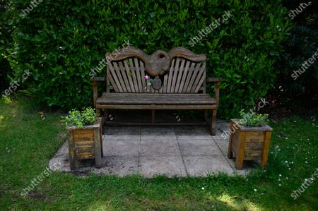 Bench with a  swan carving, dedicated to pop star, Marc Bolan, Golders Green Crematorium, Golders Green. Photograph © Jane Hobson.