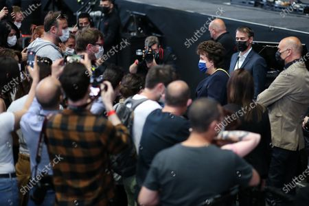 Stock Photo of Roselyne Bachelot visits audience selected to participate in the experimental concert Ambition Live Again.