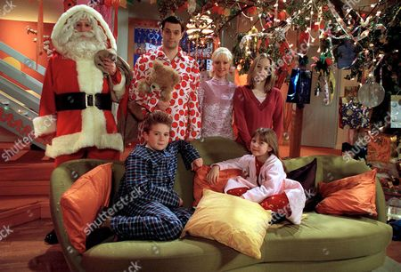 Stock Photo of Aliens Parents - Brian (Tony Gardner) and Sophie (Barbara Durkin) Experience Their First Taste of Christmas.  Also Pictured Josh (Alex Kew), Lucy (Charlotte Francis) and Mel (Danielle McCormick).