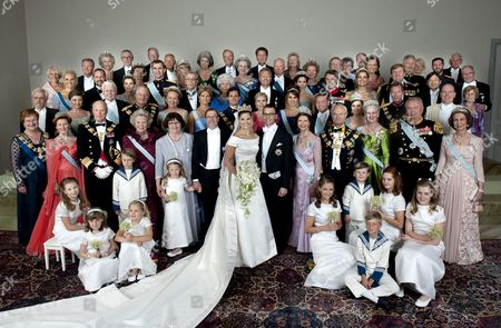 Crown Princess Victoria of Sweden, Duchess of Vastergotland, her husband Prince Daniel of Sweden, Duke of Vastergotland pose after their wedding ceremony with (L-R first row) President Mrs Tarja Halonen of Finland, Queen Sonja of Norway, King Harald V of Norway, Queen Beatrix of the Netherlands, Eva Westling, Olle Westling, Queen Silvia of Sweden, King Carl Gustaf of Sweden, Queen Margrethe II of Denmark, Prince Henrik of Denmark, Queen Sofia of Spain, (L-R second row) Pentti Arajarvi, Dorrit Moussaieff, President Olafur Ragnar Grimsson of Iceland, Queen Paola of Belgium, King Albert II, II of Belgium, Princess Madeleine of Sweden, Prince Carl Philip of Sweden, Anna Westling Blom, Queen Rania, King Abdullah II, The Grand Duke Henri of Luxembourg, The Grand Duchess Maria Teresa of Luxembourg, Prince Albert II of Monaco, (L-R third row) Crown Princess Mette-Marit of Norway, Crown Prince Haakon of Norway, Crown Princess Letizia of Spain, Crown Prince Felipe of Spain, Margaretha Ambler, Greve Count Carl Johan Bernadotte, Countess Gunnila Bernadotte of Wisborg, Mikael Soderstrom, Crown Princess Mary of Denmark, Crown Prince Frederik of Denmark, Crown Princess Maxima of the Netherlands, Crown Prince Willem-Alexander of the Netherlands, Crown Prince Naruhito of Japan. (L-R Fourth Row) Christina Magnusson, Tord Magnusson, Desiree Silfverschiold, Niclas Silfverschiold, Princess Birgitta of Sweden, Prince Johann Georg av Hohenzollern, Princess Benedikte of Denmark, Duke of Gloucester zu Sayn-Wittgenstein-Berleburg, Queen Anne-Marie, King Constantine, Crown Princess Mathilde of Belgium, Crown Prince Philippe of Guillaume de Luxemburg, (L-R Back), Ingrid Sommerlath, Walter L Sommerlath, Anna-Britta Astrom, Hasse Astrom, Ann-Catrin Westling, Nils Westling, Ralf Toldeo Sommerlath, Anita Henriksson, Olle Henriksson, Birgitta Westling and Erik West