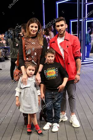 Benfica's Argentine football player Eduardo Salvio and his wife Magali Aravena and kids pose for a photo at the fashion show of the Portuguese designer Nuno Gama Fall/Winter 2019/2020 during the Lisbon Fashion Week - ModaLisboa Insight at the Carlos Lopes Hall, in Lisbon, Portugal, on March 10, 2019 in Lisbon, Portugal, on March 6, 2019. ( Photo by Pedro Fiúza/NurPhoto)