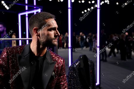 Portuguese actor Isaac Alfaiate presents a creation from the Portuguese fashion designer Nuno Gama Fall/Winter 2019/2020 collection during the Lisbon Fashion Week - ModaLisboa Insight at the Carlos Lopes Hall, in Lisbon, Portugal, on March 10, 2019 in Lisbon, Portugal, on March 6, 2019. ( Photo by Pedro Fiúza/NurPhoto)