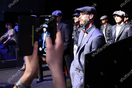 A guest takes a picture to the models at the Portuguese fashion designer Nuno Gama Fall/Winter 2019/2020 show during the Lisbon Fashion Week - ModaLisboa Insight at the Carlos Lopes Hall, in Lisbon, Portugal, on March 10, 2019 in Lisbon, Portugal, on March 6, 2019. ( Photo by Pedro Fiúza/NurPhoto)