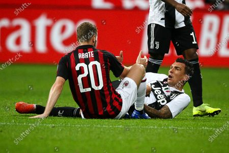 Juventus forward Mario Mandzukic (17) and Milan defender Ignazio Abate (20) lie on the pitch during the Serie A football match n.12 MILAN - JUVENTUS on 11/11/2018 at the Stadio Giuseppe Meazza in Milan, Italy.