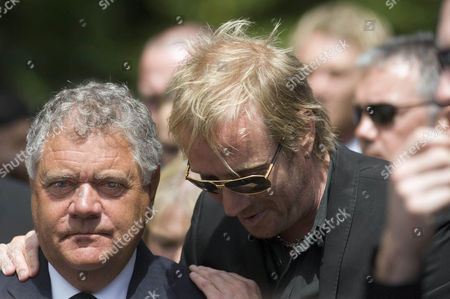 Max Boyce the entertainer is comforted by the actor Rhys Ifans