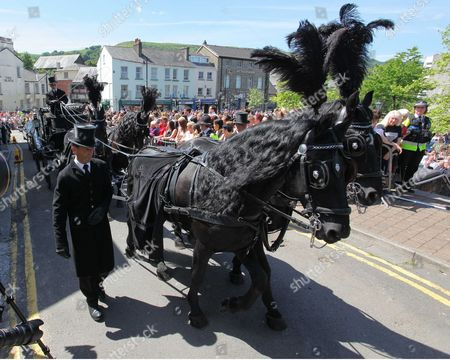 Horse-drawn funeral cortege