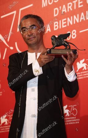 Pema Tseden poses with Orizzonti Award for Best Screenplay Award forJinpa at the Winners Photocall during the 75th Venice Film Festival  on September 8, 2018 in Venice, Italy.