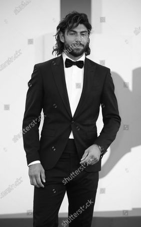 """Stock Image of (EDITOR'S NOTE: Image was converted to black and white) Ignazio Moser walks the red carpet ahead of the movie """"Sniegu Juz Nigdy Nie Bedzie"""" (Never Gonna Snow Again) at the 77th Venice Film Festival on September 07, 2020 in Venice, Italy."""