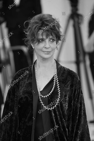 (EDITOR'S NOTE: Image was converted to black and white) Laura Morante poses on the red carpet during the 77th Venice Film Festival on September 02, 2020 in Venice, Italy.