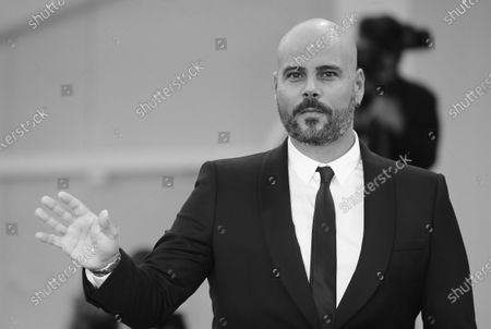 """(EDITOR'S NOTE: Image was converted to black and white) Marco D'Amore walks the red carpet ahead of the movie """"Padrenostro"""" at the 77th Venice Film Festival at on September 04, 2020 in Venice, Italy."""