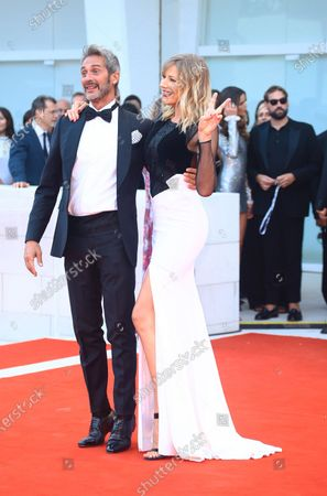 Natasha Stefanenko and Luca Sabbioni  walks the red carpet ahead of the 'Roma' screening during the 75th Venice Film Festival, in Venice, Italy, on August 30, 2018.