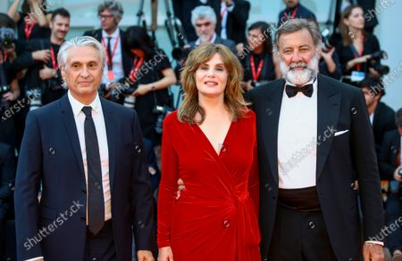 Stock Photo of (R-L) Luca Barbareschi, Emmanuelle Seigner and Alain Goldman walk the red carpet ahead of the closing ceremony of the 76th Venice Film Festival at Sala Grande on September 07, 2019 in Venice, Italy.