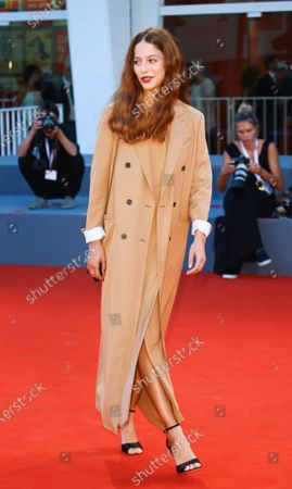 Jenna Thiam walks the red carpet ahead of the 'Capri-Revolution' screening during the 75th Venice Film Festival on September 6, 2018 in Venice, Italy.