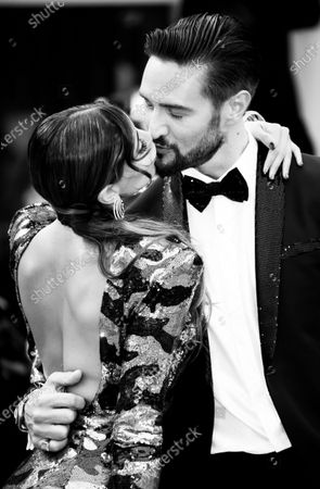 (EDITORS NOTE: Image has been converted to black and white.) Mila Suarez and  Alex Belli  walks the red carpet ahead of the 'One Nation One King (Un Peuple Et Son Roi)' screening during the 75th Venice Film Festival on September 7, 2018 in Venice, Italy.