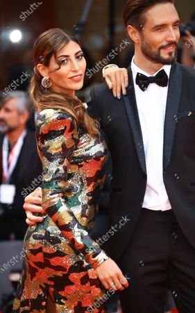Mila Suarez and  Alex Belli  walks the red carpet ahead of the 'One Nation One King (Un Peuple Et Son Roi)' screening during the 75th Venice Film Festival on September 7, 2018 in Venice, Italy.