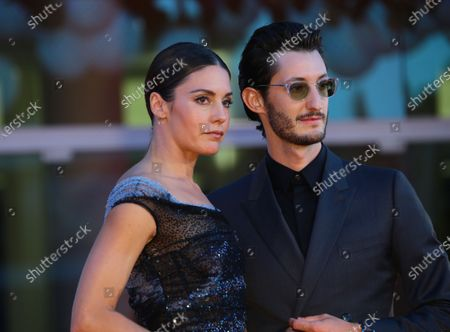 Natasha Andrews and Pierre Niney walks the red carpet ahead of the movie 'Amants' at the 77th Venice Film Festival at on September 03, 2020 in Venice, Italy.