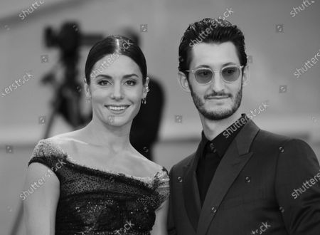 (EDITOR'S NOTE: Image was converted to black and white) Natasha Andrews and Pierre Niney walks the red carpet ahead of the movie 'Amants' at the 77th Venice Film Festival at on September 03, 2020 in Venice, Italy.