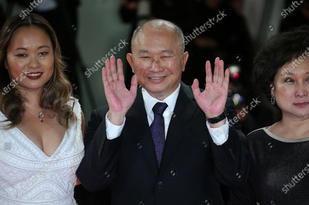 Venice, Italy. 08 September, 2017. Annie Woo Ngau Chun-lung, John Woo and Angeles Woo walk the red carpet ahead of the 'Manhunt (Zhuibu)' screening during the 74th Venice Film Festival