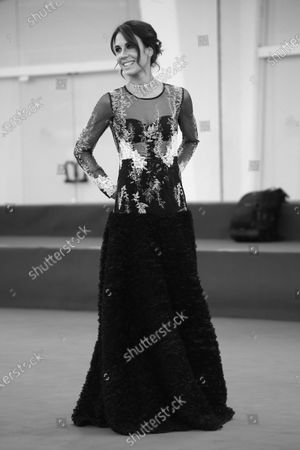 """(EDITOR'S NOTE: Image was converted to black and white) Michelle Carpente walk the red carpet ahead of the movie """"Nomadland"""" at the 77th Venice Film Festival on September 11, 2020 in Venice, Italy."""