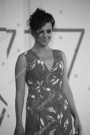 """Stock Photo of (EDITOR'S NOTE: Image was converted to black and white) Jasmine Trinca walk the red carpet ahead of the movie """"Nomadland"""" at the 77th Venice Film Festival on September 11, 2020 in Venice, Italy."""