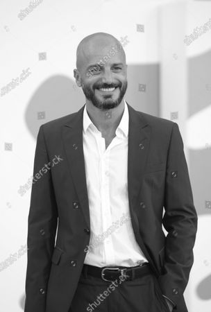 (EDITOR'S NOTE: Image was converted to black and white) Nicolas Vaporidis walks the red carpet ahead of the movie ''Le Sorelle Macaluso'' at the 77th Venice Film Festival on September 09, 2020 in Venice, Italy.