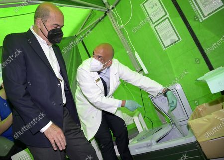 Lazio Regio President Nicola Zingaretti watches as a health worker prepares to administer the Johnson and Johnson vaccine against Covid-19 in a tent of a pharmacy in Rome, Italy, 01 June 2021. Italy has started its pharmacy vaccination campaign of the single-shot vaccine of Johnson and Johnson.