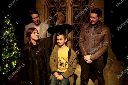 A young fan attends with Harry Potter's British actors James Phelps (L) and Oliver Phelps (R ) the opening of Harry Potter: The Exhibition in Lisbon, Portugal, on November 16, 2019. Original props, costumes and film sets of the Harry Potter movies will be exhibited from November 16 to April 8, 2020 in Lisbon.