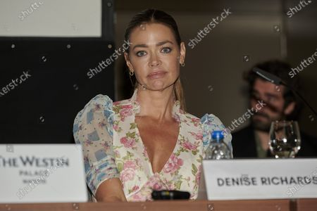 Denise Richards attends the 'Glow and Darkness' presentation photocall at Westin Palace Hotel in Madrid, Spain
