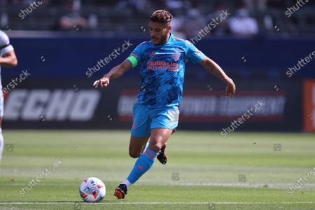 Los Angeles Galaxy midfielder Jonathan dos Santos (8) sends a pass forward during an MLS football game against the San Jose Earthquakes, Dignity Health Sports Center in Carson, Calif