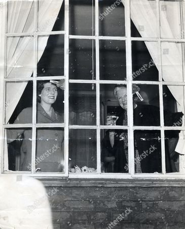 Baroness Spencer Churchill Seen Here At The Window Raising A Toast To Winston Churchill's 86th Birthday With Her Daughter Mary Soames.