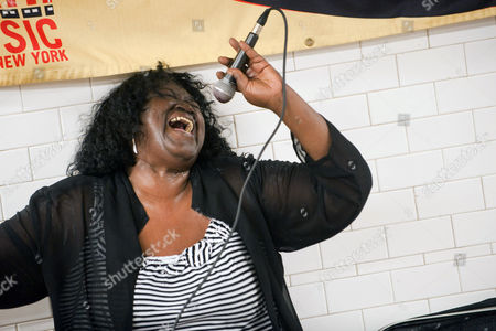 Editorial image of Alice Tan Ridley 'busking' at a subway station, New York, America - 21 Jun 2010