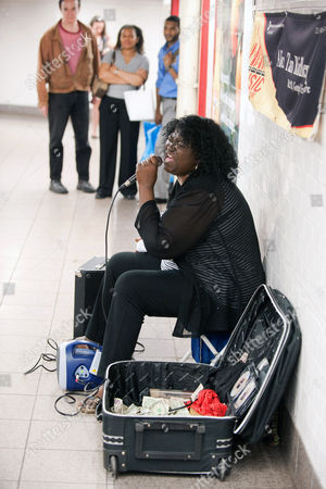 Editorial picture of Alice Tan Ridley 'busking' at a subway station, New York, America - 21 Jun 2010