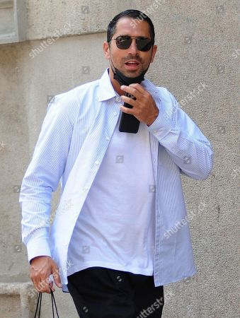 Stock Picture of Marco Borriello shopping in the center of town