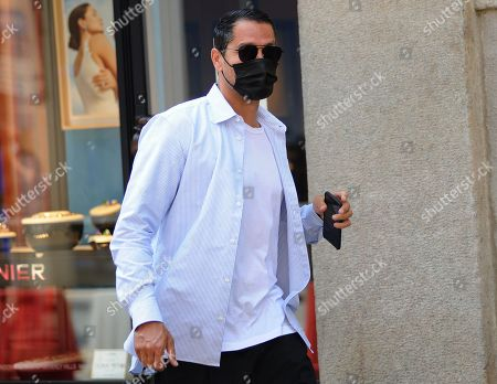 Stock Image of Marco Borriello shopping in the center of town