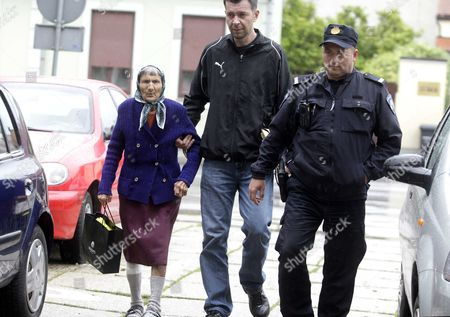 Stock Photo of Alleged murderer 86-year-old woman Alojzija Pokrivac on her way to the court house in Varazdin