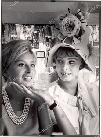 Actress Sophia Loren holding the chin of her sister, Maria Scicolone.