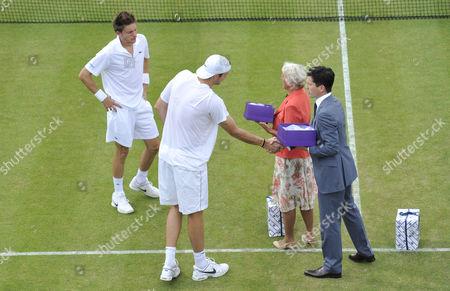 Nicolas Mahut and  John Isner during a presentation by Ann Haydon-Jones and Tim Henman