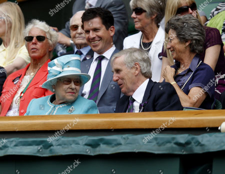 Queen Elizabeth II with Tim Phillips the Chairman of The All England Lawn Tennis Club and Ann Haydon-Jones with Tim Henman and Virginia Wade