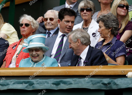 Queen Elizabeth II with Tim Phillips the Chairman of The All England Lawn Tennis Club an Ann Haydon-Jones with Tim Henman and Virginia Wade