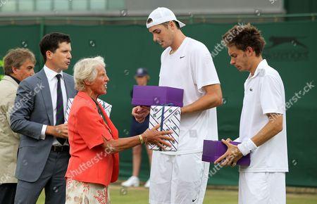 John Isner and Nicolas Mahut receive prizes from Ann  Haydon-Jones and Tim Henman