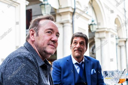 Stock Picture of Kevin Spacey and Robert Davi in a cafe in downtown Turin