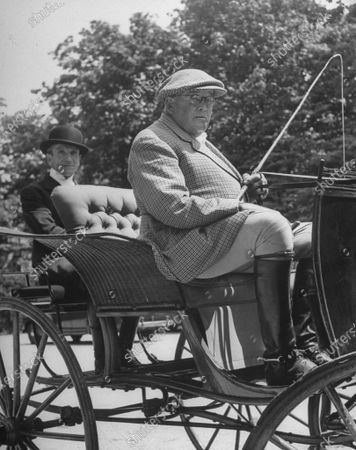 June 1946: Dean of horsey set F. Ambrose Clark, driving the horse carriage.