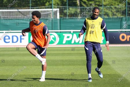 """French national soccer team """"Les Bleus"""" defender Jules Kounde exercises with goalkeeper Mike Maignan (R) during a training session in ClaireFontaine-en-Yvelines"""